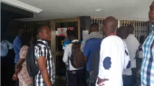 Angry uniBank customers besiege branches