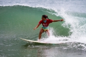 The young Indians riding a surfing wave